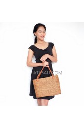 Women ata handwoven bag with wire leather handle